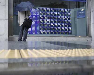 Nikkei falls below 9,800