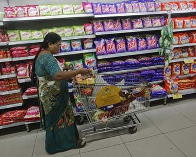 "<p><b>A woman fills her trolley with retail products as she shops at a Hypercity department store in Mumbai</b></p><p>Hypercity, the hypermarket arm of retailer Shoppers Stop, is scaling down its store rollouts and tweaking the product mix to include high-margin goods in an effort to achieve break even faster.</b></p><p>""We would like to have a medium-sized business but it has to be a profitable business. Our idea is not to build huge scale,"" Mark Ashman, chief executive of Hypercity, told Reuters.</p><p>Hypercity contributes 30% to the overall consolidated revenue of Shoppers Stop.</p><p>Most organised food and grocery retailers in India are yet to turn profitable as they operate with high costs and compete on razor-thin margins.</p>"