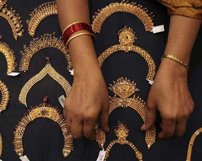 <p><b>A woman checks a gold necklace inside a jewellery showroom in Hyderabad</b></p><p>Jewellery retailer Tribhovandas Bhimji Zaveri Ltd set a price band of between Rs 120 and Rs 126 a share for its up to Rs 210-crore initial public offering.</p><p>Subscriptions to the 16.66-million-share issue will begin on April 24 and close on April 26, the company said in a newspaper advertisement on Wednesday.</p><p>A stock market rebound has boosted the outlook for share sales in India this year, with the recent offering from Multi Commodity Exchange receiving strong demand from investors.</p><p>IDFC Capital and Avendus are the lead bookrunners for Tribhovandas' share issue.</p>