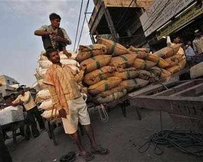 <p><b>A labourer sit on top of sacks of spices stacked on a cart at a wholesale grocery market in the old quarters of Delhi</b></p><p>Standard & Poor&#39;s said on Wednesday India&#39;s headline inflation may not show much downward movement because of structural issues and this could be a factor when the agency reviews its sovereign ratings in the next two years.</p><p>The ratings agency earlier cut India&#39;s outlook to negative from stable, citing the country&#39;s large fiscal deficit and expectations of only modest progress on reforms given political constraints.</p>