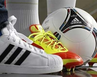 "<p><b>Different shoes and a soccer ball by German sporting goods maker are pictured before the company's annual news conference in the northern Bavarian town of Herzogenaurach</b></p><p>Germany's Adidas said it would cut the number of its Reebok stores in India by about one-third as it restructures operations in the country after discovering ""irregularities"" at Reebok India.</p><p>While the Adidas group as a whole surpassed expectations for first-quarter results, Reebok saw sales in the first three months down 7% on a currency neutral basis, Chief Executive Herbert Hainer said in a speech.</p><p>""Although Reebok has some challenges to overcome in Western Europe this year and as retailers currently focus on the major sporting events, we nevertheless continue to see good progress in most other regions,"" Hainer said.</p><p>Adidas, the world's second largest sporting goods company behind Nike, announced the irregularities at Reebok India on Monday, also releasing first quarter"
