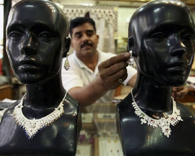 <p><b>A shopkeeper displays silver jewellery at a shop in Jammu</b></p><p>Silver jumped to its highest since early 1980 on Tuesday on inflation concerns, a rise in ETF holdings to another record and growing industrial demand, while gold hardly moved as the euro held below this week&#39;s five-month high versus the dollar.</p><p>In addition to rising investment demand for silver as a cheaper alternative to gold, an expected increase in physical buying from China was likely to support the metal, which gained 22% in the first quarter, its ninth consecutive quarterly increase.</p><p>Silver, widely used in electronics manufacturing, rose as high as $38.73 an ounce and was quoted at $38.64 an ounce, up 22 cents.</p><p>&#39;We do see a lot of demand for silver from China, so we think silver used in solar panels have increased. We think China will have a lot of demand for silver in the medium to long term,&#39; said Natalie Robertson, commodities strategist at ANZ in Melbourne.</p>