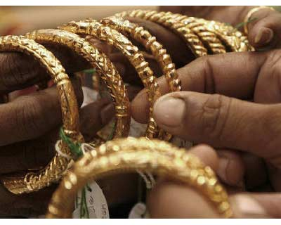 <p>A woman holds gold bangles at a jewellery shop in Kolkata</p><p><B>India gold futures extended gains for a fourth session on Friday to hit a new peak following a rally in overseas markets and a weaker rupee, which traded at its lowest level in five weeks, pushing physical traders to the sidelines ahead of a slew of festivals starting later next week</B></p><p>* The most-active gold for October delivery on the Multi Commodity Exchange (MCX) struck a record of Rs 24,300 per 10 grams, before trading 0.75% higher at Rs 24,247.</p><p>* Overseas gold edged up more than half a% as investors used bullion to shelter from the storm engulfing financial markets on concerns that the United States may be facing another recession and Europe&#39;s debt crisis is spreading to some of its largest economies.</p>