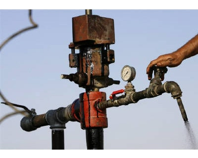 <p><b>A worker turns a valve to release drilled oil, near the Dead Sea </b>