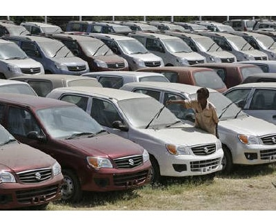 <p><b>A worker adjusts the wipers of a parked Alto car at a Maruti Suzuki stockyard on the outskirts of Ahmedabad </b></p><p>India's automobile industry is expected to grow 12 to 15% in FY12, Pawan Goenka, president of industry body Society of Indian Automobile Manufacturers (SIAM) said on Friday.</p><p>Goenka said passenger car sales are expected to grow at 16 to 18% in the year.</p><p>Car sales in India rose 24.4% in March, SIAM said, driven by a growing middle class in Asia's third-largest economy, easier access to loans and a wider choice of models.</p>