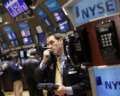 Wall Street falls on Europe, but late buying trims losses