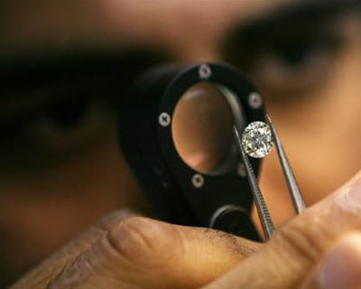 <p><b>A diamond businessmen desmonstrates a process at a diamond cutting and polishing factory in Surat in Gujarat</b> </p><p> France-based luxury conglomerate LVMH, through its unit L Capital, is set to acquire a significant minority stake in Gitanjali Gems&#39; proposed unit that will control the Indian firm&#39;s branded jewellery and retail businesses. </p><p> The deal has been estimated at $100-125 million, said two unidentified persons. </p><p> L Capital will pick up stake using money from its $500-million L Capital Asia Fund, which was raised in 2010. </p><p> L Capital India&#39;s senior official, Anuradha Raja, declined comment on the transaction. </p>