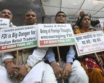 <p>Activists from Bharatiya Janata Party (BJP) hold placards while taking part in a protest against government's decision to allow Foreign Direct Investment (FDI) in the retail sector, in New Delhi</p><p><b>Fallout from a botched attempt at retail reform, a weak economy that has some analysts muttering darkly about India's balance of payments, a renewed threat of street protests and looming state elections that mean progress on tough reforms are unlikely, are the major risks to watch as the year ends in the world's largest democracy.</p><p>RATINGS (Unchanged since November unless stated):</b></p><p>S&P: BBB-</p><p>MOODY'S: Baa3</p><p>FITCH: BBB-</p>