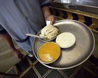 <p>A waiter carries a plate of upma at a restaurant in Mumbai</p><p><b>Energy major Reliance Industries, India's most valued company that also runs supermarkets, plans to enter the fast-food business next year, a business daily reported on Monday.</b></p><p>The company, controlled by Mukesh Ambani, India's richest man, is exploring a model on the lines of international chains McDonald's and Dominos Pizza, with a standardised menu and delivery service, the newspaper said.</p>