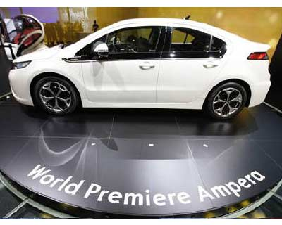 <p>The new Opel Ampera hybrid car is displayed during the first media day of the 81st Geneva Car Show at the Palexpo in Geneva</p><p><b>Electric cars and hybrids may be capturing headlines and the imagination of green-leaning consumers around the world as one automaker after another announces plans to push into the brave new world of fossil fuel-free mobility.</b></p><p>But away from the spotlight, carmakers have been quietly delivering significant cuts in CO2 emissions with some re-engineering of internal combustion engines, technology advances, weight reduction and aerodynamic improvements.</p>