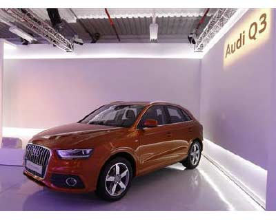 """<p>The new Audi Q3 is seen at the production facility of the Volkswagen Group in Martorell near Barcelona</p><p><b>Volkswagen&#39;s premium car brand Audi aims to overtake Daimler&#39;s Mercedes-Benz this year by racking up sales to 1.3 million vehicles, Audi&#39;s chief executive said.</b></p><p>""""We will surpass Mercedes this year and move up from position No.3 to number No.2,"""" Rupert Stadler told journalists on the sidelines of the Frankfurt auto show.</p><p>Audi was also upbeat on the economic outlook for the automotive industry.</p>"""