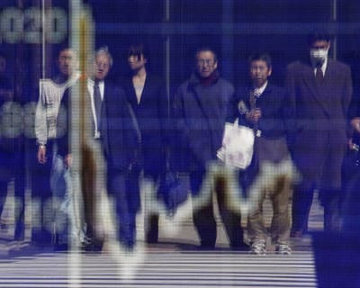 <p><b>Pedestrians are reflected in a screen displaying the stock index in Tokyo</b>