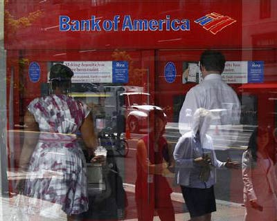 <p><b>Pedestrians are reflected in the window as customers conduct transactions at a Bank of America ATM in Washington</b></p><p>Bank of America is in exclusive talks to sell the bulk of Merrill Lynch&#39;s boom-time real estate investments to Blackstone for up to $1 billion (607 million pounds), the Financial Times reported on Wednesday.</p><p>The sale is still weeks away and would comprise between $800 million and $1 billion of unwanted property investments in Europe, the United States and South America, according to the newspaper, which cited people familiar with the matter.</p><p>The sale is part of the US bank&#39;s wider efforts to dispose of non-core assets as it tries to clear up its balance sheet and bolster capital ratios.</p><p>The talks could still fail to result in a deal, according to the article.</p>