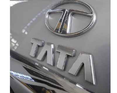 <p><b>A worker cleans a Tata Motors vehicle inside a showroom in Hyderabad</b> 