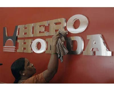 <p><b>A worker cleans a Hero Honda logo inside its showroom in Hyderabad</b></p>Hero Honda Motors, India's largest motorcycle maker, on Thursday posted a better-than-expected 13% rise in quarterly net profit, driven by strong demand and volume growth.</p><p>The company reported net profit of Rs 558 crore ($125.5 million) for the first quarter ended June, compared with Rs 492 crore a year earlier. Net sales rose to Rs 5,638 crore from Rs 4,265 crore.</p>