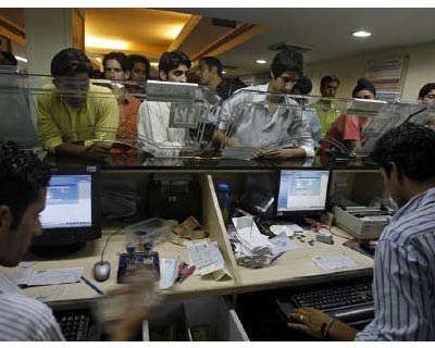 <p><b>Kashmiri people perform transactions at a bank in Srinagar</b></p><p>Private sector lender Kotak Mahindra Bank on Thursday posted a 27% growth in June quarter consolidated net profit led by higher loan growth and better asset quality.</p><p>The bank said its net profit in the June quarter rose to Rs 416 crore from Rs 328 crore a year ago. Its net interest income (NII) grew to Rs 920 crore from Rs 725 crore a year ago.</p><p>Kotak, in which private equity Warburg Pincus LLC holds more than 9%, said its net interest margin, a key gauge of profitability, for the quarter-ended June fell to 5% from 5.4% a year ago.</p>