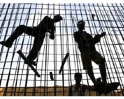 "<p>Labourers fasten iron rods together at the construction site of a commercial complex in Ahmedabad</p><p><b>Infrastructure company Hindustan Construction Co (HCC) on Friday said it posted a net loss in July-Sept. due to higher interest burden and significant delays in new infrastructure project allotments, sending its shares down nearly 5%.</b></p><p>""We are facing rough weather and this is the best we could do, of course this is also the monsoon period and that has its own share of delays,"" Chairman and Managing Director Ajit Gulabchand, told reporters.</p>"