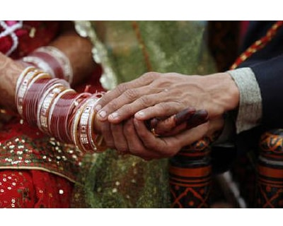 <p><b>A couple take their wedding vows during their wedding ceremony in Ahmedabad </b>