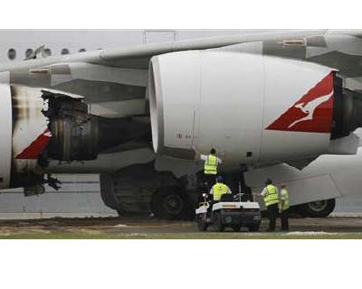 "<p><b>Technicians work next to the damaged engine of a Qantas Airways A380 passenger plane flight QF32 after it was forced to make an emergency landing at Changi airport in Singapore</b></p><p>Australia&#39;s biggest airline Qantas has reached a commercial settlement with engine maker Rolls-Royce over the disruptions caused by an engine explosion on an Airbus A380 last November.</p><p>Qantas said the terms of the settlement were confidential, but the ""profit and loss impact of the settlement, which will be recognised in Qantas&#39; financial results for FY 2011, is A$95 million.""</p>"