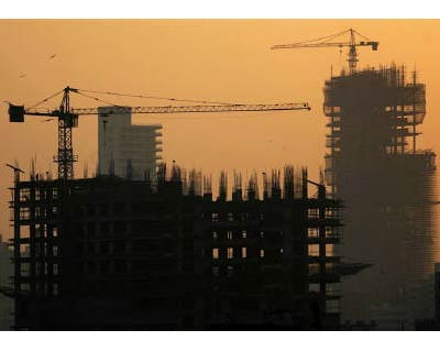 <p><b>Buildings under construction are seen along the Mumbai skyline</b></p><p>India is nearing the end of its credit tightening cycle, as 10 interest rate increases since March 2010 exact a toll on growth in a once-roaring economy, making Tuesday's expected rate rise potentially the last for the near future.</p><p>Growth rates are still expected to be around 8%, which means India is not heading for a sharp slowdown even if the road ahead is filled with speed-bumps and the country's economic engines are not firing on all pistons.</p><p>However, recent industrial output and manufacturing data was the worst in nine months, car sales are skidding and loan demand is slowing, even as the Reserve Bank of India (RBI) readies yet another increase in interest rates.</p><p>India's dream of annual growth of 10% appears increasingly distant.</p><p>The rate increases have been needed to fight persistent inflation, which is running about 9% and some economists predict a return to double-