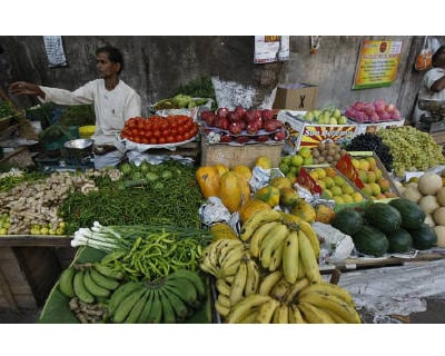 <p><b>A vendor waits for customers at his vegetable and fruit shop at the wholesale market in Mumbai </b>