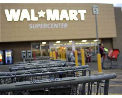 <p><b>Shopping carts are seen outside a Wal-Mart Supercenter in Coolidge, Arizona</b></p><p>Wal-Mart Stores Inc and its foundation said on Thursday that it had committed $25 million to help provide food, education and jobs for children during school summer break, but opponents of the retailer&#39;s urban expansion plans questioned its motives.</p><p>The new campaign from the world&#39;s largest retailer, and the Walmart Foundation, comes after April&#39;s announcement that Wal-Mart and its foundation gave away $316 million in cash and $480 million in in-kind contributions in the fiscal year that ended on January 31. A significant part of that giving directed to local food banks.</p><p>Wal-Mart has been steadily increasing the volume of its contributions in New York City and Washington DC, cities where no Walmart stores actually exist. Its motives for escalating donations to these cities have been questioned by neighborhood activists and labor groups.</p>