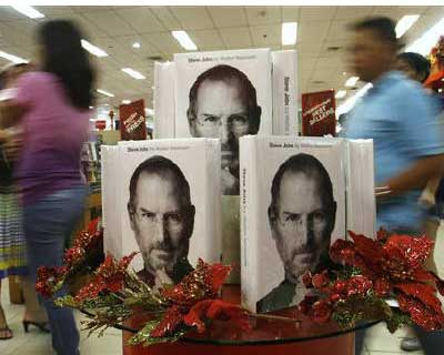 """<p>Customers walk past a display of the biography of Steve Jobs, sold at a bookstore in Quezon City, Metro Manila</p><p><b>Apple co-founder Steve Jobs revolutionised multiple industries with his cutting-edge products but he was not the world's best manager, biographer Walter Isaacson said.</b></p><p>Jobs changed the course of personal computing during two stints at Apple and then brought a revolution to the mobile market but the inspiring genius is known for his hard edges that have often times alienated colleagues and early investors with his my-way-or-the-highway dictums.</p><p>Isaacson's biography """"Steve Jobs,"""" which hits bookstores on Monday, reveals that Jobs refused potentially life-saving cancer surgery for nine months, was bullied in school, tried various quirky diets as a teenager, and exhibited early strange behavior such as staring at others without blinking.</p>"""