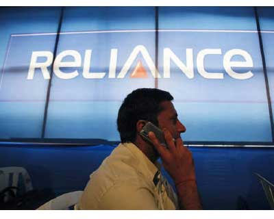 <p>A shareholder speaks on a mobile phone in Mumbai</p><p><b>A unit of Reliance Communications, part of billionaire Anil Ambani&#39;s Reliance Group, filed a petition on Monday to overturn charges against the firm and three of its executives related to a multi-billion dollar telecoms scam, the company said in a statement.</b></p><p>A special court charged Reliance Telecom, a subsidiary of India&#39;s second-largest mobile operator, and the executives, with breaking rules to gain 2G telecom spectrum in 2008 as part of one of India&#39;s biggest corruption scandals said to have cost the state $39 billion in revenue.</p>