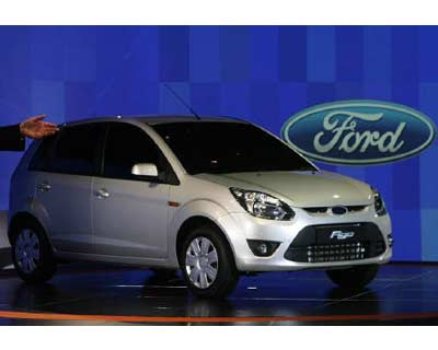 <p><b>Ford&#39;s &#39;Figo&#39; car stands on display during its launch ceremony in New Delhi</b></p><p>Ford Motor Co plans to build a $900 million production plant at Sanand in Gujarat, doubling its investment in the country, as the second-largest US carmaker seeks to catch up with rivals in the second-fastest growing auto market in the world.</p><p>The planned factory in pro-business Gujarat is expected to be running by 2014 and will employ 5,000 people, the company said.</p><p>With initial annual production capacity of 240,000 vehicles, the plant will bring Ford&#39;s total capacity in India to 600,000 and reduce the cost of getting vehicles to market. Ford has another plant in Chennai.</p><p>The US firm is not alone in boosting investment in India, where car sales jumped 30% in the year to March to close to 2 million.</p><p>Others such as Toyota Motor Corp, Nissan Motor Co, Volkswagen and General Motors are lining up new models and adding investment.</p>