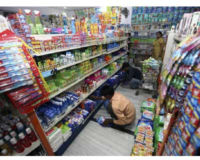 <p><b>Workers arrange consumable goods as a customer shops at a grocery store in Lucknow</b></p><p>Hindustan Unilever, the Indian unit of Anglo-Dutch Unilever Plc, beat forecasts and posted an 18% jump in quarterly net profit helped by a one-time gain.</p><p>The largest Indian household products and consumer goods maker said on Thursday net profit rose to Rs 627 crore ($142 million) for the first quarter ended June 2011 from Rs 533 crore a year ago.</p>