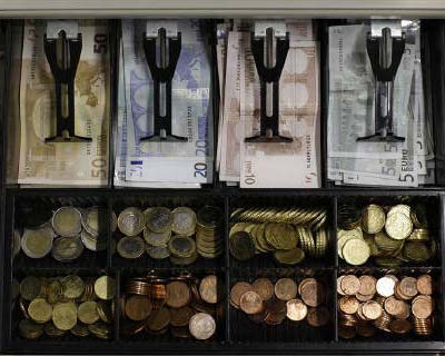 <p>Euro banknotes and small coins are pictured in open cash register in a shop in Olching</p><p><B>Bankers are bracing for a second round of losses on Greek debt if an earlier promise to write off 37 billion euros ($50 billion) is insufficient to help the struggling country stave off default.</B></p><p>German Chancellor Angela Merkel suggested this week that the details of a second international Greek bailout, hammered out in July with support from banks who agreed to share the 109 billion euros burden with taxpayers, may have to be renegotiated.</p>