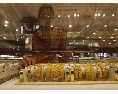 <p><b>A saleswoman arranges gold jewellery inside a showroom in Kolkata</b></p><p>Gold snapped a three-day gaining streak on Monday following similar trend globally. A strong rupee also made the dollar-quoted yellow metal cheaper, triggering a slight pick-up in physical demand ahead of key festivals.</p><p>At 1:14 pm, the most-active gold for October delivery on the Multi Commodity Exchange (MCX) was trading 1.95% lower at Rs 27,099 per 10 grams.</p><p>Global spot gold fell more than 1%, reversing a rally of 3.2% in the previous session, as investors, faced with uncertainties over the US Federal Reserve&#39;s stimulus plans, decided to take some money off the table.</p>