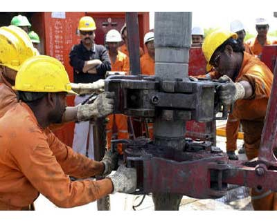 <p>Engineers of ONGC work inside the Kalol oil field in Gujarat</p><p><B>ONGC, which has been investing heavily to maintain output from its old fields, aims to raise its crude oil production by 14.6% by March 2014, its new chairman said on Tuesday.</B></p><p>Vasudeva said his aim is to raise the firm's oil output to 28 million tonne or 560,000 barrels per day (bpd) by March 2014 and gas production by 58% to 36.5 billion cubic metres by March 2017.</p><p>India, the world's fourth-biggest oil importer, buys in nearly 80% of its oil needs as expanding refining capacity has outpaced growth in local oil output. ONGC's local oil output has been almost stagnant in the last five years.</p>