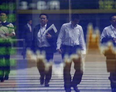 <p>Pedestrians are reflected in a screen displaying the stock index prices in Tokyo</p><p><b>World stocks hit a fresh 15-month low on Tuesday and the euro fell across the board as the growing prospect of a near-term default by Greece stoked fears of a major banking crisis in Europe, which would accelerate a global economic slowdown.</b></p><p>The cost of insuring German sovereign debt against default hit a record high for a second day in a row, reflecting concerns that the Eurozone&#39;s paymaster-in-chief will have to dig ever deeper into its pockets to bail out the region&#39;s weaker states.</p><p>A fresh sell-off in risky assets began after Eurozone finance ministers said they were reviewing the size of private sector involvement in a second bailout package for Greece, a move that could undermine the aid plan and hasten a default.</p>