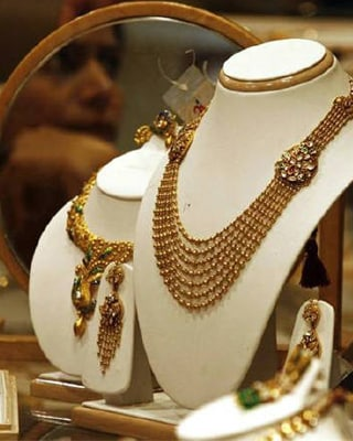 <p><b>A woman is reflected on a mirror inside a gold jewellery shop in Ahmedabad</b> </p><p> India gold futures on the Multi Commodity Exchange struck a record high of Rs 20,887 ($466) per 10 grams on Tuesday tracking overnight rise in international markets. </p><p> The contract breached the previous record of RS 20,874 struck on November 30. </p><p> International gold hit a record high in the previous session on worries over Europe&#39;s sovereign debt problems and speculation the US Fed will extend monetary easing.  </p><p>