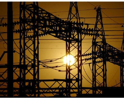 <p><b>The sun sets behind electric pylons in Allahabad</b> 