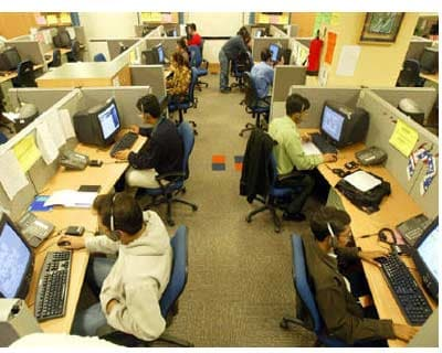 <p><b>Engineers attend to calls from abroad inside a call center in Gurgaon</b>