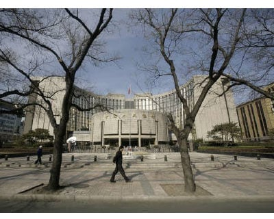 <p><b>People walk past the headquarters of the central bank of the People&#39;s Republic of China in Beijing</b> </p><p> China will probably raise lenders&#39; required reserves once again this month to soak up excess cash in the economy and tamp down on inflation, the official China Securities Journal reported on Thursday. </p><p> In a front-page article, the newspaper cited industry analysts as saying that a surge in capital inflows and a large volume of maturing bills would prompt the People&#39;s Bank of China to increase reserve requirements for the third time this year. </p>
