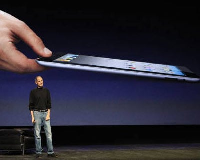 <p><b>Apple CEO Steve Jobs introduces the iPad 2 on stage during an Apple event in San Francisco, California</b> </p><p> A thin but energetic Steve Jobs made a surprise return to the spotlight on Wednesday, taking the stage to unveil Apple Inc&#39;s new iPad and drawing a standing ovation. </p><p> The Silicon Valley legend has been out on medical leave since late January and his reappearance, in trademark turtleneck and jeans, bolstered Apple shares and reassured investors and fans worried about his health. </p>
