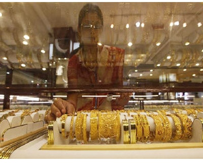 <p><b>A saleswoman arranges gold jewellery inside a showroom in Kolkata</b> </p><p> India December gold futures on the Multi Commodity Exchange (MCX) extended gains on Tuesday to a new record high of Rs 19,390 per 10 grams, surpassing the previous peak of Rs 19,368 struck on September 23. </p><p> At 1:05 pm, the contract was trading at Rs 19,380, up 0.73 per cent, tracking firm overseas markets and a weaker rupee, which makes the dollar-quoted yellow metal expensive. </p>