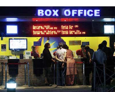 <p><b>People buy tickets at a counter in a multiplex movie theatre in Mumbai</b>