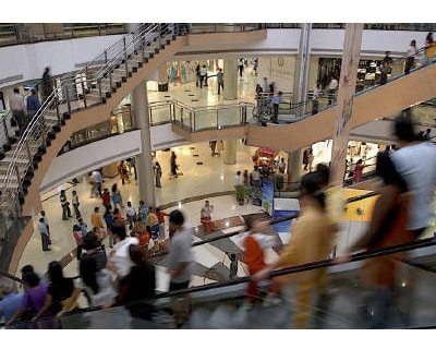 <p><b>People are pictured inside a shopping mall in Mumbai July 28, 2007. India has not yet decided on allowing foreign direct investment into multi-brand retail, Trade Minister Anand Sharma said on tuesday</b>