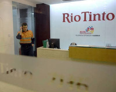 <p><b>An employee talks on his mobile at the Rio Tinto Limited Shanghai Representative Office in Shanghai.</b>