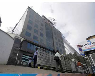 "<p>Security personnel stand guard in front of SKS Microfinance&#39;s head office in of Hyderabad</p><p><b>Lender SKS Microfinance, whose shares have taken a massive beating amid ballooning provisions, expects near-term pain and predicts consolidation in the embattled sector, the firm&#39;s top executives said on Tuesday.</b></p><p>""Probably there would be near-term pain for a quarter or two,"" SKS chief financial officer Dilli Raj told reporters at a briefing on Tuesday.</p><p>India&#39;s once-thriving microfinance sector has been reeling since Andhra Pradesh, that was its largest market, clamped down on business practices such as high interest rates and aggressive loan recovery practices last October.</p><p>Loans as low as Rs 2,000 at interest rates that have topped 30% are used by India&#39;s poor for ventures such as buying livestock or opening a tea stall.</p>"