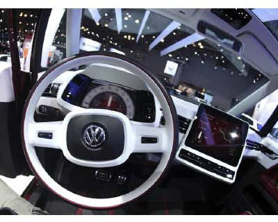 <p>The interior of a Volkswagen microbus concept car is seen at the New York International Auto Show in New York City</p><p><b>Top European automaker Volkswagen AG said that it would build electric cars in China with FAW Group, becoming the first foreign automaker to announce concrete plans to make electric cars in the country under a home-grown brand.</b></p><p>The electric vehicle (EV) under the new brand Kaili would be built by FAW Volkswagen, and China&#39;s Ministry of Industry and Information Technology certified the vehicle on May 3, Volkswagen said in an email to Reuters on Wednesday.</p>