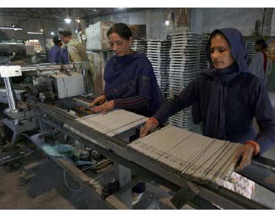 <p><b>Labourers work inside an electrode factory on the outskirts of Jammu</b></p><p>India's industrial output in May rose a slower-than-expected 5.6% from a year earlier, government data showed on Tuesday.</p><p>April's industrial output growth was revised downwards to 5.8% from 6.3%.</p><p>Manufacturing output, which constitutes about 80% of the industrial production, rose an annual 5.6%, the federal statistics office said in a statement.</p><p>During April-May, industrial output grew 5.7% from 10.8% a year ago.</p><p>Industrial output grew 7.8% in FY11 that ended in March, slower than 10.5% clocked in the previous fiscal.</p>