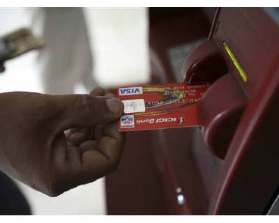 <p>A customer uses his card to withdraw money from an ATM in Jammu</p><p><b>India banks are pushing plastic again, hoping that credit card sales will lift profits in a market where the competition is tough, the opportunity large, and the risks high.</b></p><p>Fewer than 18 million of India&#39;s 1.2 billion people use credit cards. In China, a country with a slightly higher population, more than 200 million credit cards were in use as of a year ago.</p><p>Lenders in India say a focus on higher end customers will be key to the success of a second credit card push, but if history is a guide, it still faces high hurdles.</p><p>India&#39;s banks cancelled millions of cards when a wave of customer defaults followed aggressive growth pre-financial crisis. Banks vow to be more selective this time as they tap rising spending power and the high interest rates and fees they can charge on cards.</p>