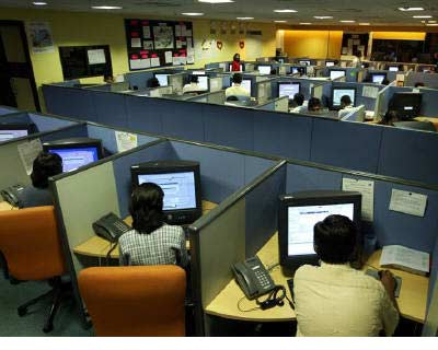 <p><b>File photo of people working at a call centre in Bangalore</b>