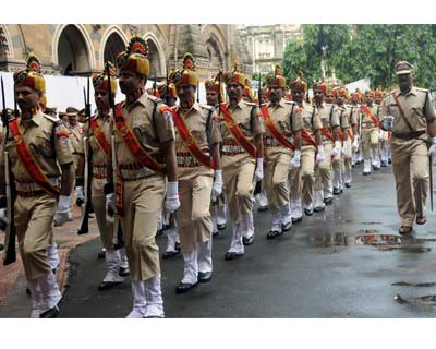<b>ALWAYS READY:</b> Mumbai police contingents march during Independence Day celebrations. A tight security has been thrown over the city on the occasion.