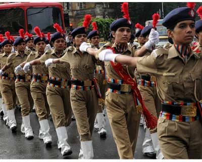 <b>WHY SHOULD BOYS HAVE ALL THE FUN:</b> Women police force march during Independence Day celebrations.